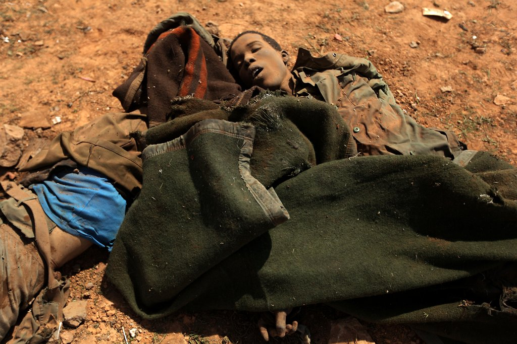 """Это вам не резиновые пули """"кровавого"""" Каддафи."""