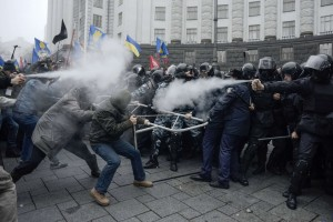 Protestors clash with riot police during a rally to support EU integration in central Kiev