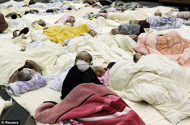 Sleeping: People who are evacuated from a nursing home which is located in evacuation area around the plant rest at a temporary shelter in Koriyama today  Read more: http://www.dailymail.co.uk/news/article-1365781/Japan-earthquake-tsunami-All-3-Fukushima-nuclear-plant-reactors-meltdown.
